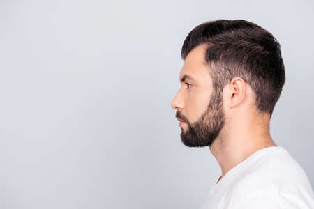 Photo for Side profile portrait of a brunet guy, isolated on pure light blue background. - Royalty Free Image