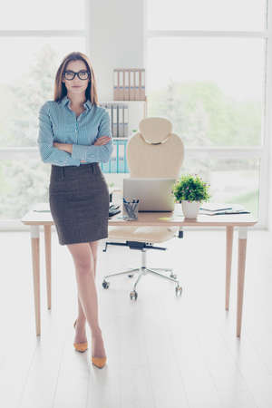 Foto de Success concept. Full length portrait of serious young business lady economist in glasses and strict formal wear, standing at her office - Imagen libre de derechos
