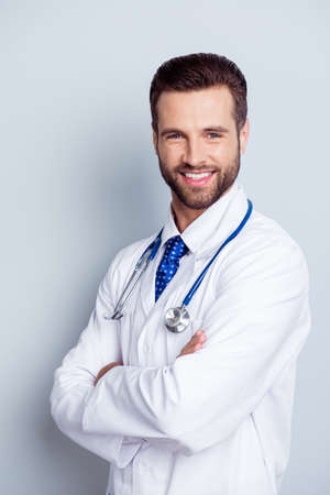 Photo for Authority and success concept. Young handsome and stylish bearded professor of medicine in white uniform is standing at the pure white background with smile - Royalty Free Image