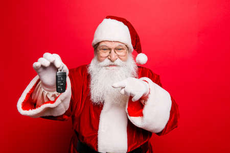 Photo for Cool funny playful naughty Santa Claus grandfather fooling around - Royalty Free Image