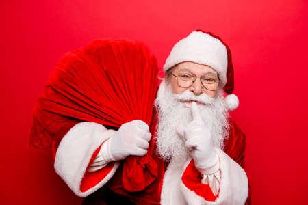 Foto de Cool funny playful naughty Santa Claus grandfather fooling around - Imagen libre de derechos