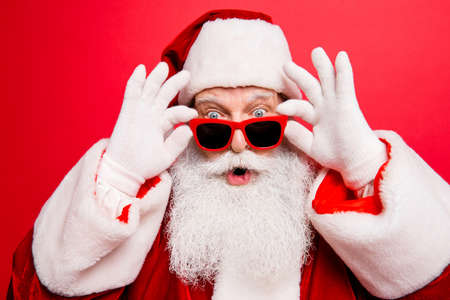 Foto de Cool funny playful naughty Santa Claus grandfather fooling around - Imagen libre de derechos