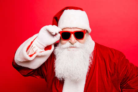 Photo for Cool funny playful naughty tourist santa grandfather, fooling around, holding his trendy specs, so confident - Royalty Free Image