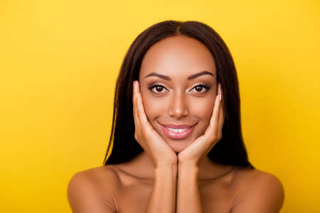 Photo pour Gogreous, charming, pretty, hot nude afro brunette lady is touching gently her attractive healthy smooth skin, shiny, clean and pure. Women beauty and health, wellness, make up, pampering concept - image libre de droit