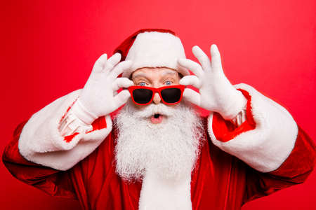 Photo for Holly jolly x mas noel! Increadible unbelievable crazy december surprise travel trips time omg! Closeup of aged excited astonished tourist santa with wide open eyes, mouth, adjusting eye wear - Royalty Free Image