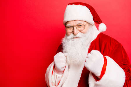 Foto de Festive sporty grandfather with fists. Newyear fight, fit, boxer, boxing, athlete, strength, attack, authority, muscular, sport, training, masculinity, gifts, presents, noel x mas concept - Imagen libre de derechos