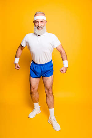 Photo for Full length of cheerful excited mature modern macho goofy cool competetive pensioner leader grandpa champion practising bodybuilding. Body care, strength, leadership, motivation lifestyle - Royalty Free Image