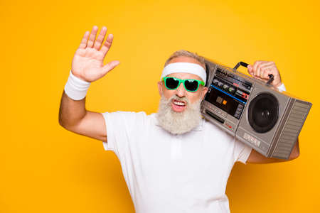Photo for Cheerful excited aged funny sexy gangster cool grandpa dude in eyewear with bass clipping ghetto blaster recorder. Old school, swag, fooling, gym, technology, success, hip hop - Royalty Free Image