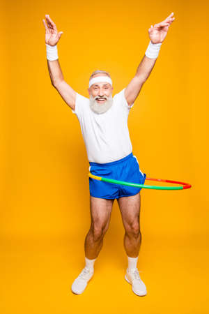 Photo for Emotional cool cheerful excited crazy funny fooling playful gymnast grandpa with comic grimace, exercises for fit figure. Body care, hobby, weight loss, game process - Royalty Free Image