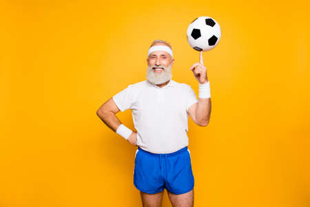 Photo for Cool funny modern competetive pensioner, leader, champion plays with ball - Royalty Free Image
