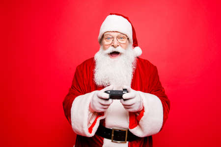 Photo pour Holly jolly x mas festive noel carefree, chill, entertainment, leisure, tradition time! Funny santa in headwear, costume, black belt, white gloves playing videogames on tv, winning crazy car race - image libre de droit