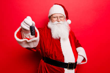 Foto de Funny aged grandfather in red traditional outfit and headwear. X mas noel time! Success, happiness, surprise, dream, december, buyer, ownership, property, purchase, rent, sell, cars concept - Imagen libre de derechos