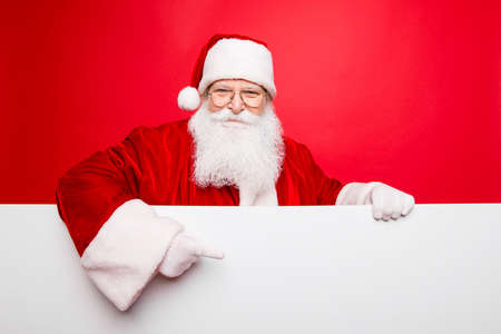 Photo for Advertisement, discounts, presents gifts selling december, winter tradition wish, celebration of christmastime  concept. Santa is standing behind the white blank banner and points at side, empty - Royalty Free Image