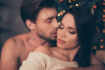 Foto de Closeup of brunet partner with bristle hold his brunette from back, cute feelings,  temptation pleasure, smooth skin, intense, tender, celebrate christmastime - Imagen libre de derechos