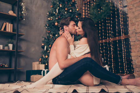 Photo pour Side profile view of brunet partner with bristle hold cuddle sensual sexual his brunette lady, cute feelings, horny hot naughty passion, temptation pleasure, celebrate christmastime - image libre de droit