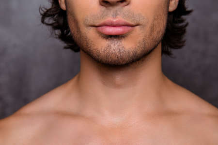 Photo pour Close up cropped shot of nude hot guy`s bristle, chin, has perfect skin and hair, isolated on grey background. Barber shop, beard cut, shaving and styling concept - image libre de droit