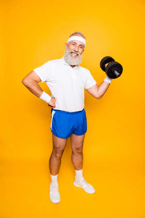 Photo pour Full length of cool crazy insane emotional active grandpa with win happiness grimace, exercising, training, holding equipment, lifts it up, wears sexy shorts, sneakers, so hot! - image libre de droit