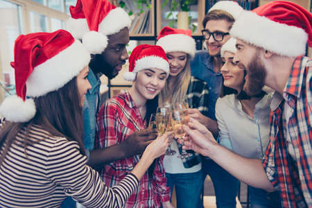 Photo pour Close up portrait of mixed race, multi national businessmen and businesswoman, joyful bearded employers and beautiful entrepreneurs, toasting their glasses with champagne, enjoying christmas corporate, party makers in the campus - image libre de droit