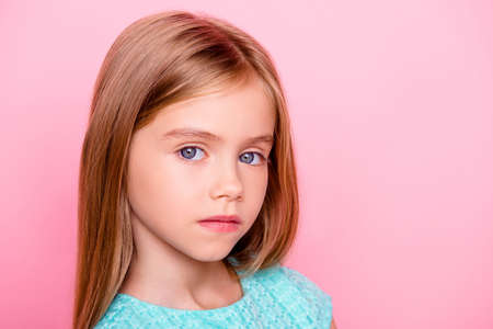 Photo pour Close up portrait of cute nice lovely charming adorable beautiful confident concentrated little girl with big blue eyes - image libre de droit