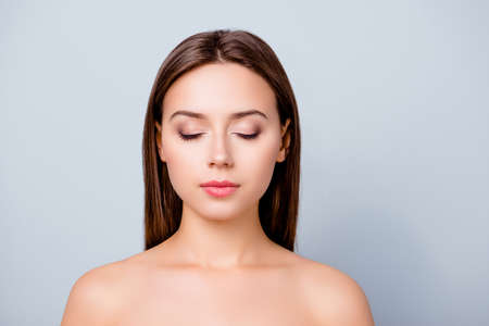 Photo pour Close up photo of beautiful woman's face, her eyes are closed, she has perfect make up and hairdo, isolated on grey background, copyspace - image libre de droit
