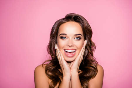 Photo pour Aging, acne, pimples, wrinkles, oily, dry skin concept. Close up cropped photo of pretty excited lady with wavy hairdo, arm palms near face, happiness and freshness, purity - image libre de droit