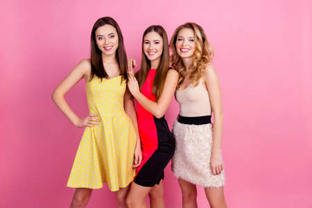 Foto de Three happy beautiful girls, party time of stylish girls group in elegant dresses celebrating birthday, women's day, having fun, girlfriends posing for the camera over pink background - Imagen libre de derechos