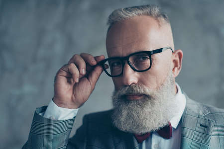 Photo for Close up portrait of elegant rich confident smart with modern hairdress haircut white beard creative virile dreamy luxurious pensive freelancer touching black rim-glasses isolated on grey background - Royalty Free Image