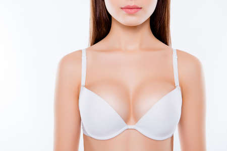 Foto für Cropped close up photo of sexy woman's breast wearing white classic elegant brassiere she has clean clear sensual fresh  pure skin, skinny slim slender body isolated on background - Lizenzfreies Bild