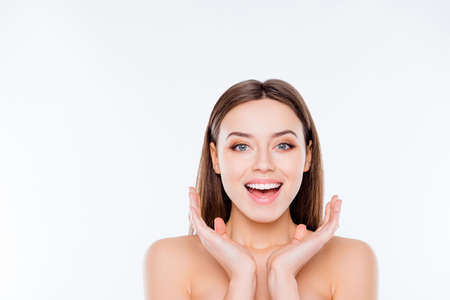 Photo pour Wellness vitality sensitive concept. Close up portrait of excited attractive tender with soft smooth flawless ideal face after therapy holding hands near face isolated on white background copy-space - image libre de droit