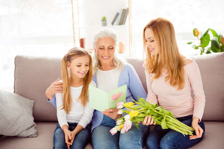 Photo for Handmade poem pleasure looking draw picture heart freshness concept. Friendly cute kind cheerful excited delightful adorable sweet cute tender gentle family members reading greeting from card on sofa - Royalty Free Image