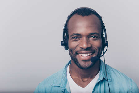 Photo pour Close up portrait of cheerful positive smart clever friendly guy wearing casual clothing using headphones - image libre de droit