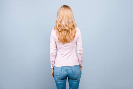 Foto de Back rear view photo of beautiful successful professional wearing casual clothes woman staying still, isolated on grey background - Imagen libre de derechos