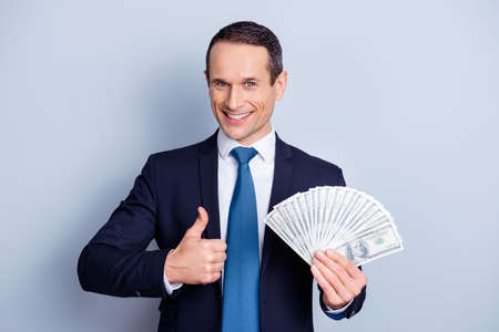 Photo for Close up portrait of cunning suspicious confident wealthy satisfied businessman wants you to be business partners investors, making finger up symbol isolated on gray background - Royalty Free Image
