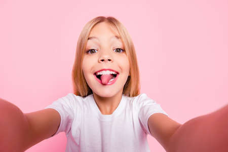 Photo for Style play stylish trend glamorous toothy fun-time comedian humor tongue-out concept. Close up portrait of sweet cute lovely adorable carefree playful girl taking selfie isolated on pink background - Royalty Free Image