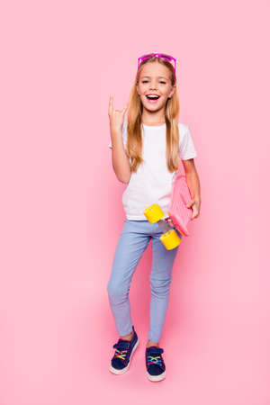 Photo pour Trendy fashion style stylish funtime concept. Vertical full-size full-length portrait of laughing cute sweet adorable lovely charming girl denim jeans white tshirt blue shoes isolated pink background - image libre de droit