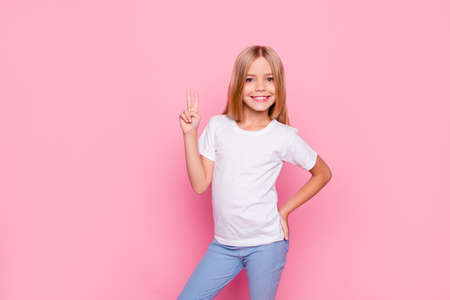 Foto de Fun joy enjoy people person funtime concept. Portrait of cute lovely carefree confident sweet adorable beautiful girl in casual modern outfit demonstrating v-sign isolated on pink background - Imagen libre de derechos