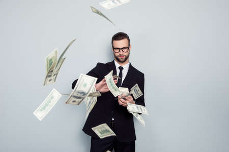 Photo for Banker increase profit lottery jackpot shower waste posh chic classy wealthy stack dealer dealing costly throw expensive concept. Proud arrogant tricky handsome guy sharing money isolated background - Royalty Free Image