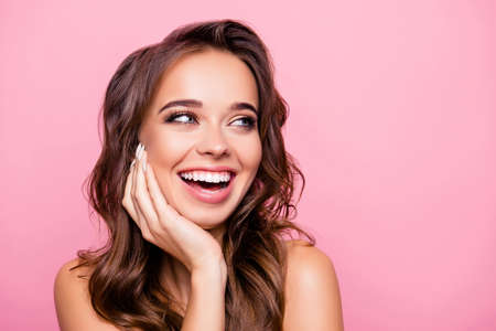 Photo pour Aging, acne, pimples, wrinkles, oily, dry skin concept - close up portrait of pretty excited lady with wavy hairdo, holding palms on cheek, isolated on pink background - image libre de droit