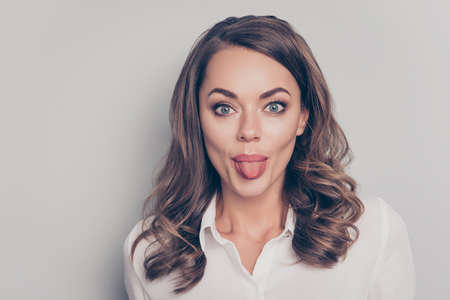 Photo for Portrait of nice, cute, trendy, pretty, charming, pretty, positive, crazy, comic woman with curls hairdo gesturing tongue out looking at camera isolated on grey background - Royalty Free Image