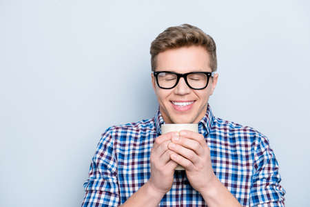 Foto de Aromatic university person delight pleasure concept. Close up portrait of rejoicing funny funky cheerful joyful cute lovely guy drinking fresh tasty coffee isolated on gray background copy-space - Imagen libre de derechos