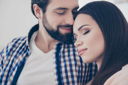 Photo pour Close up cropped portrait of romantic attractive cute couple missed each other long time, bonding with close eyes, Idyllic harmony affection true feelings concept - image libre de droit