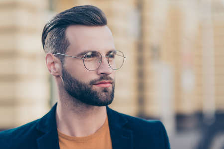 Photo pour Portrait with copy-space of smart thoughtful man with modern hairdo beard looking away isolated on blurred background. People person society authority concept - image libre de droit