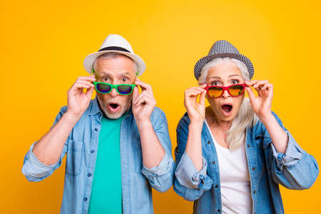 Photo pour Success win winner victory facial expressing hipster concept. Close up photo portrait of two excited astonished scared beautiful handsome people touching glasses isolated background - image libre de droit