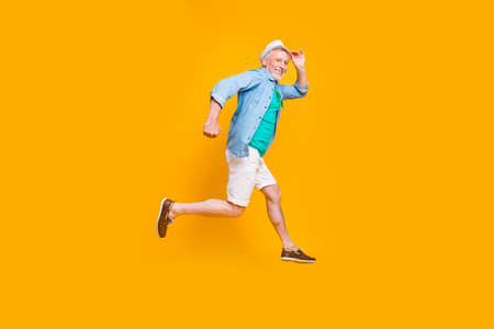 Foto de Happiness emotion facial expressing hold hand empty place concept. Turned full length size view photo portrait of cheerful excited lovely cute handsome gentleman jumping up isolated vivid background - Imagen libre de derechos