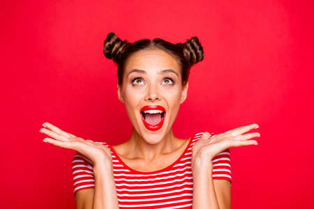 Photo pour So excited and positive girl isolated on red background loud laughs raising her head and hands up. Concept of advertising, sale and discount - image libre de droit