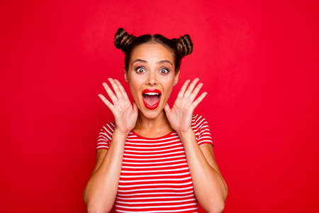 Foto de WOW! Portrait of astonished surprised girl with wide open mouth eyes gesturing with palms near face isolated on red background - Imagen libre de derechos