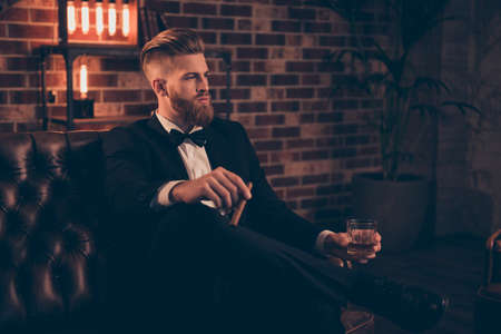 Foto de Posh chic wealthy lifestyle concept. Profile side-view portrait of serious thinking focused concentrated pensive stylish trendy rich arrogant freelancer chief sharp-dressed holding cigar beverage - Imagen libre de derechos