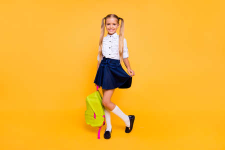 Foto de Full length, legs, body, size portrait of sweet, gorgeous, adorable, small blonde girl stand isolated on shine yellow background - Imagen libre de derechos