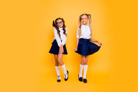 Foto de Full length, legs, body, size portrait of cheerful, cute, nice, lovely, sweet, adorable small girls stand isolated on vivid yellow background - Imagen libre de derechos