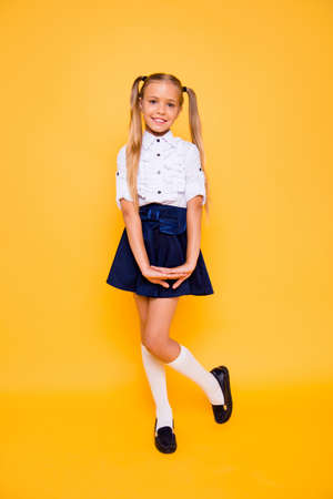 Foto de Full length, legs, body, size vertical portrait of gorgeous, good-looking small blonde girl stand isolated on shine yellow background - Imagen libre de derechos
